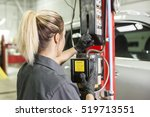 a mechanic woman working on car ... | Shutterstock . vector #519713551