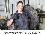 a mechanic woman working on car ... | Shutterstock . vector #519716635