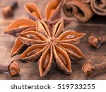 star anise on wooden background ... | Shutterstock . vector #519733255