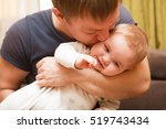 young father kisses with his... | Shutterstock . vector #519743434