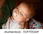 the baby sleeps on hands at... | Shutterstock . vector #519755269