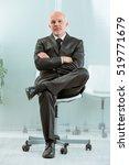 stern office worker sitting on... | Shutterstock . vector #519771679
