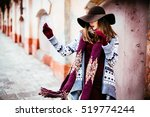 lady in the hat   throws a  red ... | Shutterstock . vector #519774244