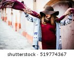 lady in the hat   throws a  red ... | Shutterstock . vector #519774367