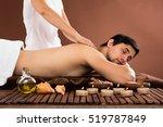 young man receiving shoulder... | Shutterstock . vector #519787849