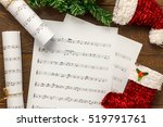 Small photo of Top view Christmas background.music note paper with decorations and ornaments on wooden table and copy space.