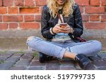 hipster sitting on the ground... | Shutterstock . vector #519799735