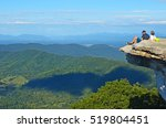 Backpackers Enjoy The View At...