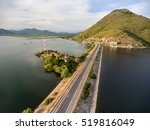 Panoramic view at the dam with railroad and highway passing across the Skadar lake and near Lesendro fort. Route from Podgorica to Adriatic coast. Montenegro