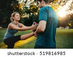 male physical trainer assisting ... | Shutterstock . vector #519816985