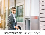 indian business man at the atm... | Shutterstock . vector #519827794
