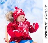 little girl enjoying a sleigh... | Shutterstock . vector #519840649