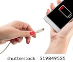 female hand holding low battery ... | Shutterstock . vector #519849535