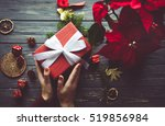 Woman Preparing Gift Box For...