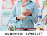 woman doing grocery shopping at ... | Shutterstock . vector #519858157