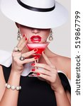 a girl in a white hat covers... | Shutterstock . vector #519867799