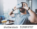bearded man wearing virtual... | Shutterstock . vector #519893707