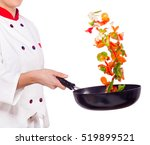 female cook frying vegetables...