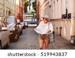 cheerful woman wanderer with... | Shutterstock . vector #519943837