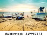 old fishing boats laid over the ... | Shutterstock . vector #519953575