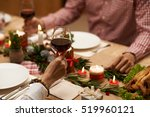 hands of couple drinking red... | Shutterstock . vector #519960121