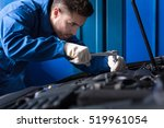 concentrated mechanic repairing ... | Shutterstock . vector #519961054