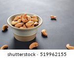roasted salted cashew nuts in... | Shutterstock . vector #519962155