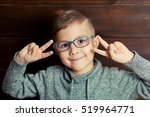 happy smiling boy in glasses... | Shutterstock . vector #519964771