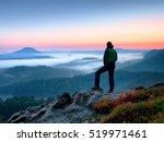 hiker  man on rock watch over... | Shutterstock . vector #519971461