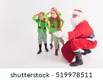 santa claus and kids dressed in ... | Shutterstock . vector #519978511