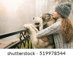 Stock photo image of young girl with her dog alaskan malamute outdoor 519978544