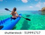 Beautiful Young Woman Kayaking...