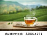 cup of hot tea and tea leaf on... | Shutterstock . vector #520016191