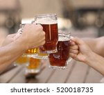 people drinking beer in cafe | Shutterstock . vector #520018735