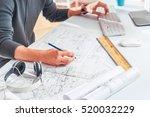 hands of engineer drawing on... | Shutterstock . vector #520032229