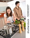 young couple cooking together... | Shutterstock . vector #52003357