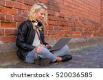 woman working on her laptop | Shutterstock . vector #520036585