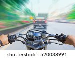 a man riding a motorcycle ... | Shutterstock . vector #520038991