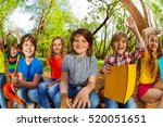 smiling kids reading a book in... | Shutterstock . vector #520051651