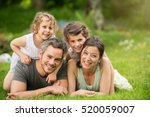 cheerful family in a park ... | Shutterstock . vector #520059007