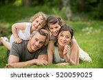 cheerful family in a park  dad  ... | Shutterstock . vector #520059025
