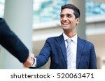 businesspeople shaking hands... | Shutterstock . vector #520063471