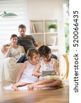 cheerful family at home  two... | Shutterstock . vector #520066435