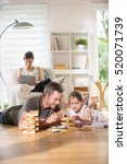 cheerful family at home  daddy... | Shutterstock . vector #520071739