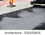 Asphalt Paving With A Steel...