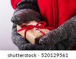 open hands holding a present... | Shutterstock . vector #520129561