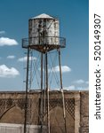 Old Rusty Water Tower Next To A ...