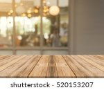 wood table top on blur kitchen... | Shutterstock . vector #520153207