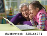grandmother and granddaughter... | Shutterstock . vector #520166371