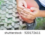 male knee injury and pain. | Shutterstock . vector #520172611